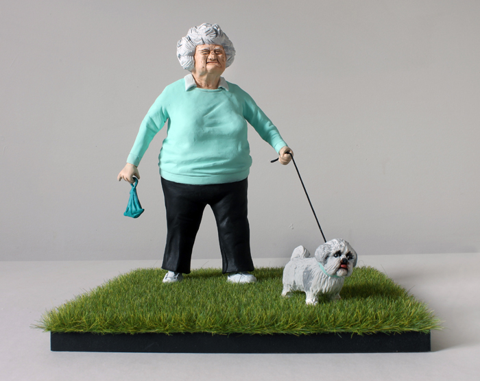 Mrs Jorgensen and Ronnie woman walking a dog by sculptor wilfrid wood